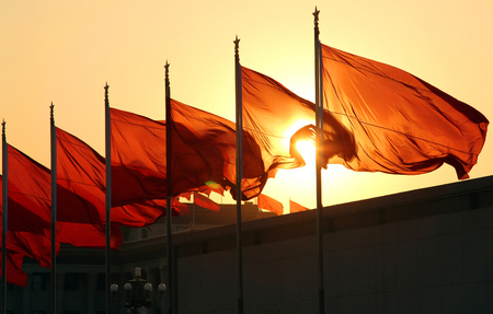 red flags at sunrise Stock Photo