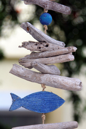 Handmade wooden decorative element in form of fish in the garden Stock Photo