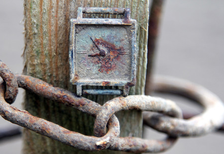 Old rusty clock on a chain