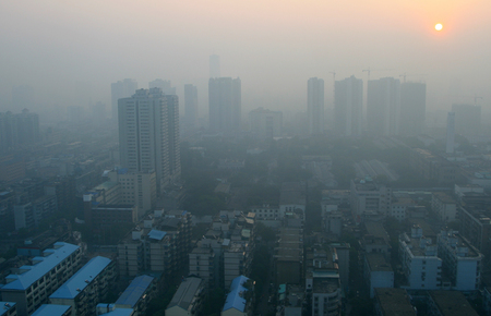 Sunrise through the smog in a modern Chinese city