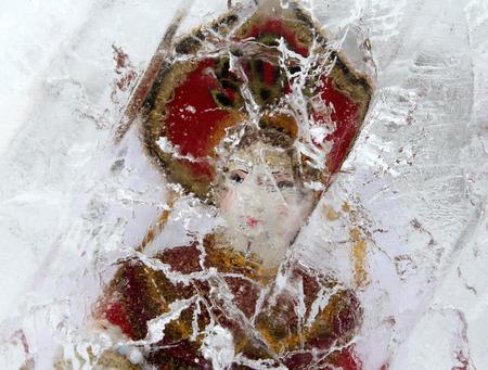 craquelure: Russian doll in ice block
