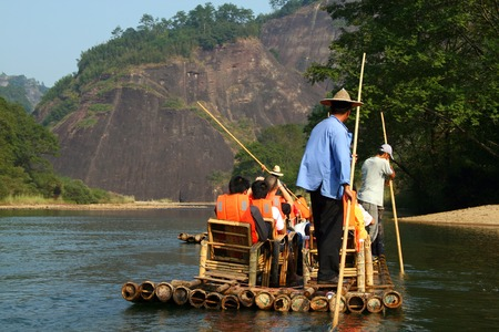 punting: Rafting on the River of Nine Bends, Wuyishan, China Stock Photo