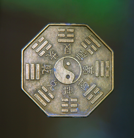 yin yang sign surrounded by Trigrams and hieroglyphs