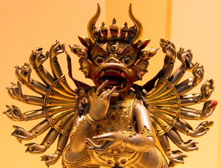gelugpa: St. PETERSBURG, RUSSIA - JUL 4, 2014: Bronze Tibetan statue of 19th century in Museum of History of Religion. This is Vajrabhairava, buddhist patron of Gelugpa shcool in Tibetan buddhism Editorial