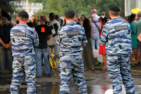 berets: MOSCOW, RUSSIA - AUG 2, 2014: Russian soldiers of Special Purpose Mobile Unit (OMON, or Black Berets) monitoring compliance with the order at a crowded event Editorial