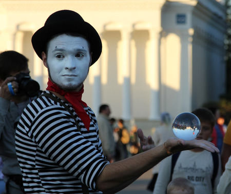 MOSCOW, RUSSIA - SEP 7, 2014: Clown with a magic crystal ball on a holiday devoted to the City Day of Moscow at All Russian Exhibition center Editorial