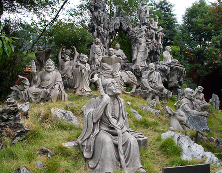 16: HENG SHAN, HUNAN, CHINA - OCT 15, 2009: Monument of 18 (16) Arhats in the garden behind Nanyue Damiao temple (Grand Temple of South Mountain). The eighteen arhats are a popular subject in Buddhist art
