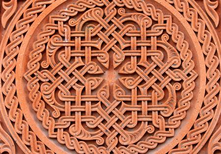 Traditional tufa stone carving ornament on a wall of Armenian Orthodox Church