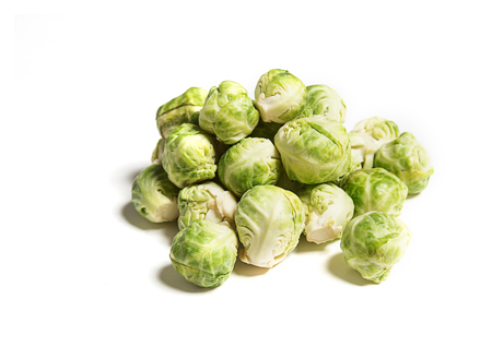 Fresh green baby brussels sprouts isolated on white