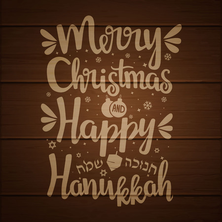 Hand written lettering with text Happy Hanukkah and Merry Christmas on wooden background.