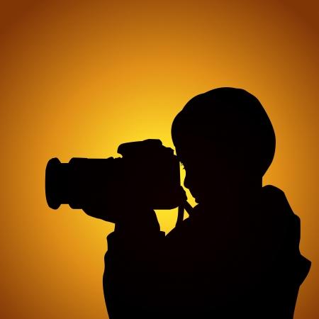 amateur: El fotógrafo chico al atardecer