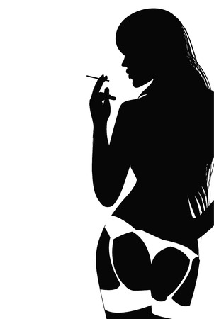 Silhouette of young woman in lingerie smoking a cigarette.