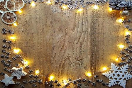 Christmas decorations and christmas light bulbs arrange in heart shape on wooden table. Free space for your text
