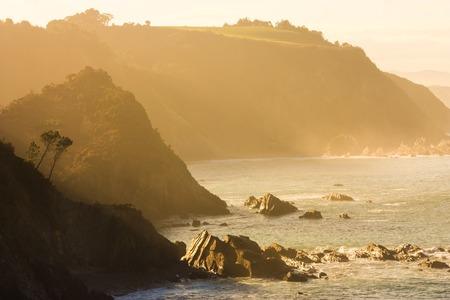 Natural sepia coastal sunset scene in North Spain