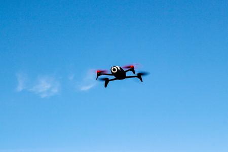 Flying drone in the sky Stock fotó
