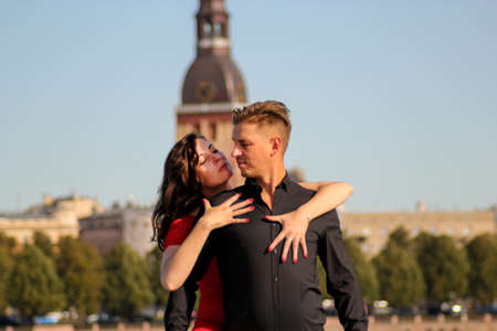 Young couple in love embraced together, isolated on cityscape. Concepts about travel, relationships and lifestyle.