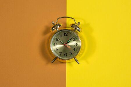 yellow clock on a yellow brown background 版權商用圖片