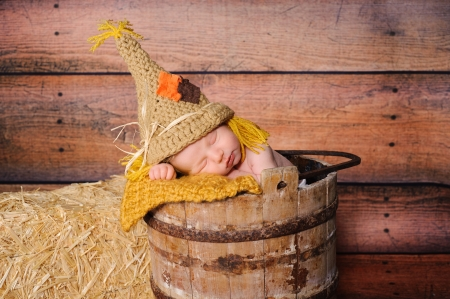 11 day old newborn baby boy wearing a crocheted scarecrow costume   Stock Photo