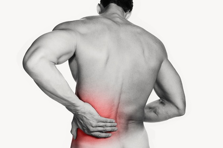 Black and white photo of a muscular man with a backache  Red selective color further illustrates pain Stock Photo - 16495032