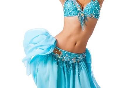 Belly dancer in a light blue costume shaking her hips