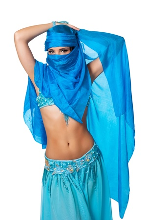 Belly dancer peeking from behind a blue veil