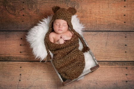 Sleeping Newborn Baby Boy Wearing a Bear Hat photo