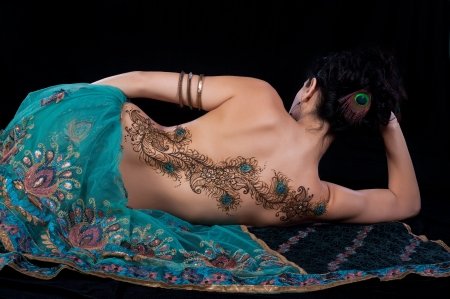 black  tattoo: Peacock Feather Henna Design on a Womans Back