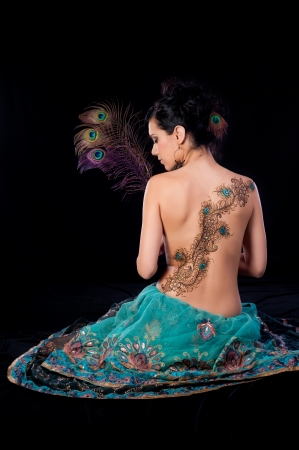 Peacock Feather Henna Design on a Womans Back