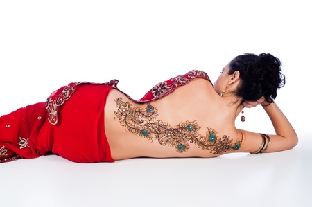Woman in a Red Sari with Henna Design on her Back