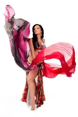 Belly Dancer Dancing with Multicolored Veils photo
