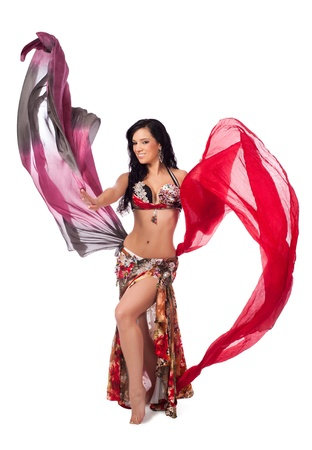 Cheerful Belly Dancer Dancing with Multicolored Veils photo