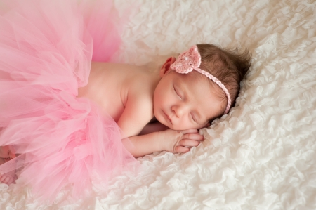 Newborn Baby Girl Wearing a Pink Tutu photo
