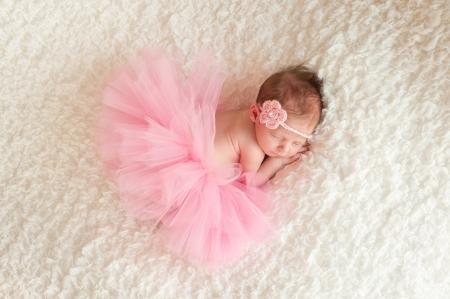headband: Newborn Baby Girl Wearing a Pink Tutu