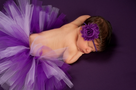 headband: Newborn Baby Girl Wearing a Purple Tutu