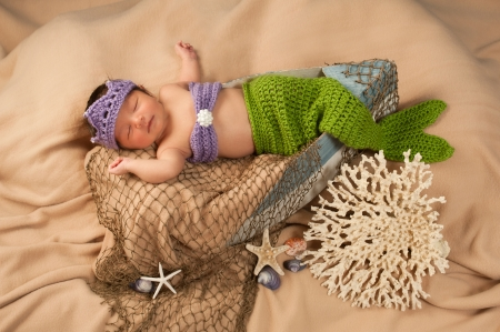 Newborn Baby Girl Wearing a Mermaid Costume photo