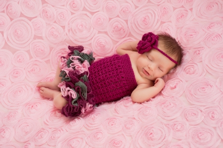 Newborn Baby Girl Wearing a Crocheted Romper photo