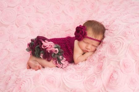 romper: Newborn Baby Girl Wearing a Crocheted Romper
