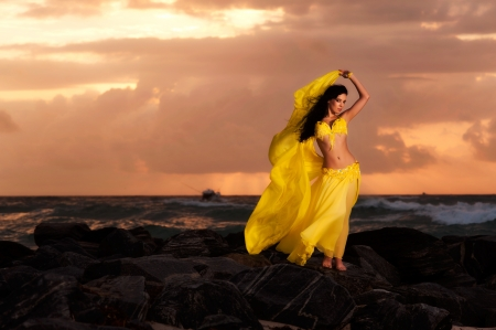 turkish woman: Belly Dancer in Yellow Costume on the Beach at Sunrise
