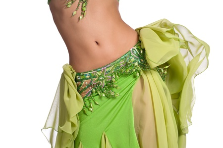 Close up shot of a belly dancer wearing a green costume and shaking her hips  Isolated on white  Clipping path included so image can be easily transferred to a different colored background  photo