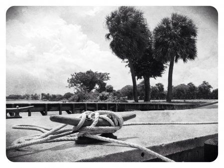 cleat: Black and white nautical image of a boat dock cleat Stock Photo