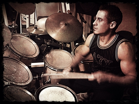 drum kit: Sepia Toned Image of a Muscular Man Playing Drums