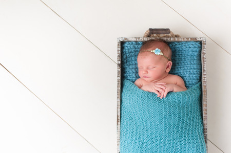 Portrait of a sleeping nine day old newborn baby girl.