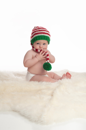 38980602 - Newborn baby wearing a knitted Christmas elf hat. Similar  Images. Add to Likebox. A seven month old baby boy sitting on a sheepskin  rug. 2096f397d0e1