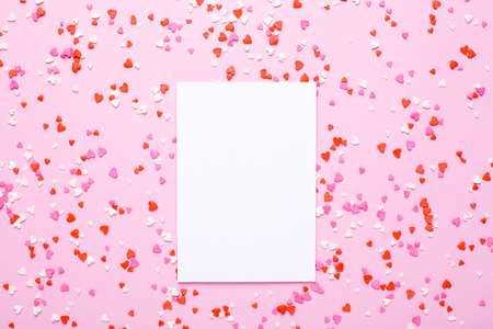 Present card with pink, red hearts on pink background top view Stock Photo