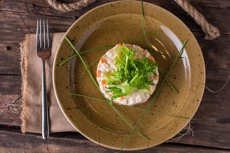 Vegetable salad with sauce and herbs on a restaurant plate