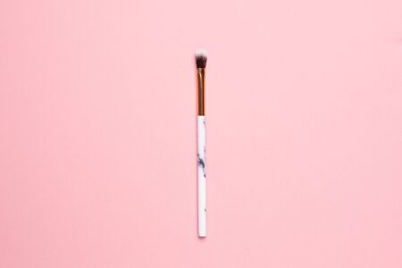 Beauty make up brushes on a pink background 写真素材
