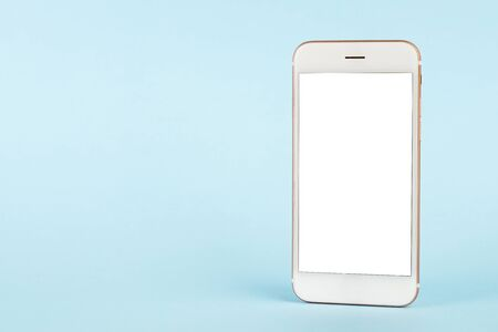 Mobile phone with copy space on blue background, minimal technology concept side view