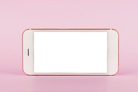Mobile phone with copy space on pink background, minimal technology concept side view 版權商用圖片 - 132125270
