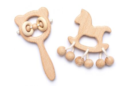 Baby wooden rattles and toys on white backgroun isolated Archivio Fotografico