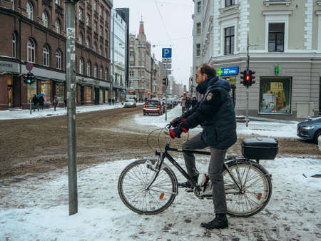 Finland, Helsinki 12 14 20 Cyclist on the city roadway . Winter snowy day view